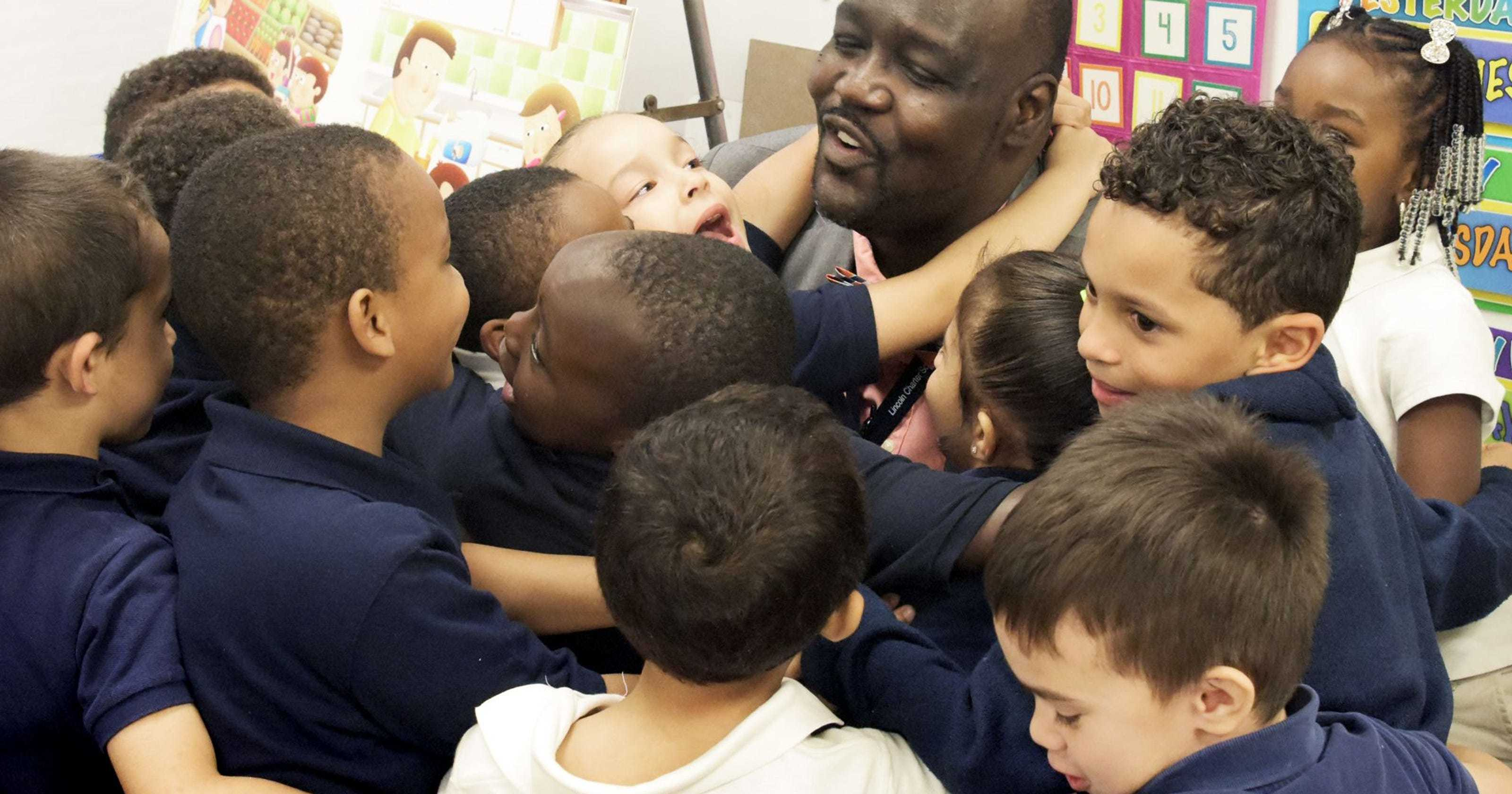 Principal receives hugs from students
